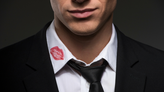 Red lipstick on cheating husband's collar